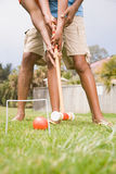 Two people playing croquet Stock Photo
