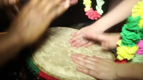 Two people playing on Jambe Drum no face. Closeup of man's hands drumming out a beat on an African skin-covered djembe stock video footage