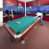 Two people playing pool Royalty Free Stock Photos