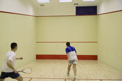 Two people playing squash Stock Image