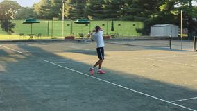 Two people playing tennis. A view or scene of Relaxation stock video