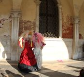 Two people posing in costumes Venice Carnival 2019. royalty free stock images