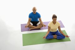 Two people practicing yoga. Royalty Free Stock Photo