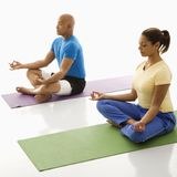 Two people practicing yoga. Royalty Free Stock Photography