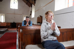 Two people praying Stock Image