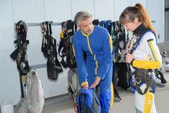 Two people preparing for parachute jump Stock Images
