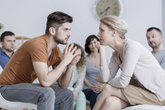 Two people during psychotherapy. Two people during behavioral  psychotherapy in group Stock Image