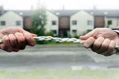 Two people pull the rope. Against each other Stock Photo