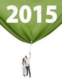 Two people pulling a flag new year Royalty Free Stock Image