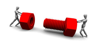 Two People Pushing Nut & Bolt Together Stock Photo