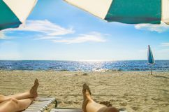 On vacation relaxing on a beach Royalty Free Stock Photos