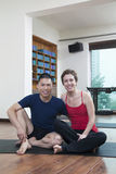 Two people relaxing and looking at camera in a yoga studio royalty free stock photography