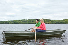 Two people riding in a canoe on a lake Royalty Free Stock Photography