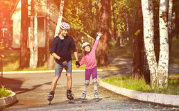 Two people rollerblade Royalty Free Stock Images
