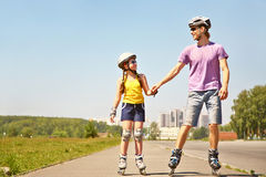 Two people rollerblade Stock Photography