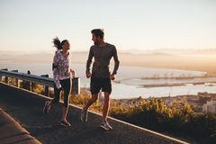 Two people running on a country road in morning Stock Photography