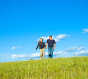 Two people running on a meadow Royalty Free Stock Photography