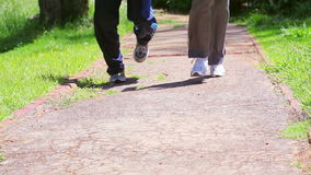 Two people running on a path. In a parkland stock footage