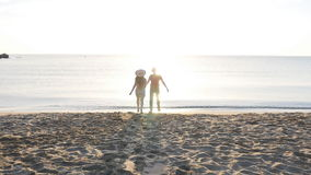 Two people running playful holding hands on summer travel holidays stock video