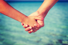 Two people's hands Royalty Free Stock Images