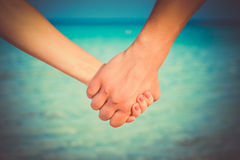 Two people's hands Stock Photos