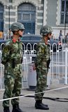 Two People's Liberation Army unformed soldiers stand guard around Tiananmen Square Beijing China. Beijing, China - October 18, 2015: Two uniformed Chinese Stock Images