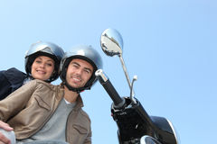 Two people on scooter Royalty Free Stock Images