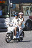 Two people on a scooter in Rome Stock Photo