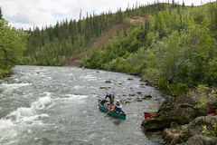 Adventure canoeing on wild, remote Alaskan river Stock Photo