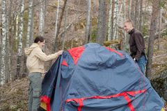 Two people set up a tent Royalty Free Stock Images
