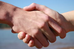 Two People Shaking Hands In Agreement Royalty Free Stock Photography