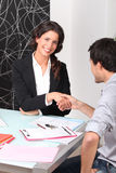 Two people shaking hands Stock Image