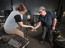 Two People Shaping Glass Stock Image
