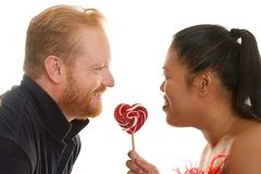 Two people share a candy Stock Image