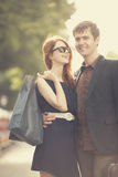 Two people with shopping bags Royalty Free Stock Image