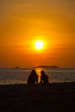 Two People Silhouette Watching Sunset Beach Ocean Royalty Free Stock Image
