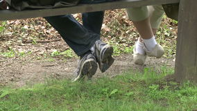 Two people sitting on a bench in a Nature Reserve (3 of 3). A view or scene of people stock footage