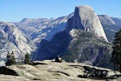 Two People Sitting on Mountain Edge stock photos