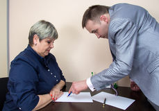 Two people sitting in office and talking. Photo of people in office Royalty Free Stock Photo