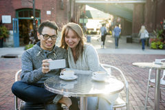 Two people with smartphone in cafe Stock Images