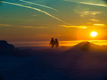 Two people are on the snow Royalty Free Stock Photos