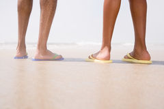 Two people standing on a beach Stock Photos