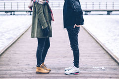 Two people standing on the pier Stock Image