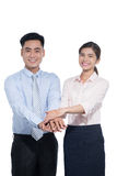 Two people standing with their hands on top each other and smiling Royalty Free Stock Image