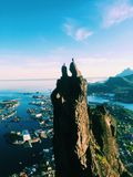 Two People Standing on Top of Mountain With Views of City in Port stock photo