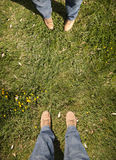 Two people stood on grass Royalty Free Stock Photography