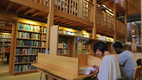 Two people studying. In library stock video