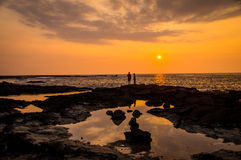 Two people at sunset in Twostep, Hawaii, USA. Two people looking at sunset in Two-step, Big Island, Hawaii. Two-step is famous for its great diving and Royalty Free Stock Images
