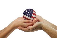 Two people take hands together Stock Photo