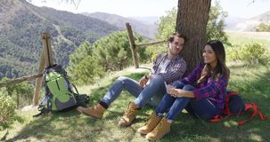 Two people taking rest under tree stock footage